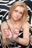 Attractive blonde stretches out her hands in chains — Stock Photo