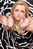 Pretty blonde stretches out her hands in chains — Stock Photo
