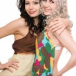 Stock Photo: Portrait of two attractive young women. Isolated