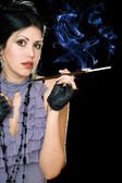 Portrait of a brunette with cigarette holder — Stock Photo