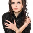 Portrait of charming young brunette in black clothes — Stock Photo