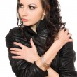 Portrait of graceful young brunette in black clothes — Stock Photo
