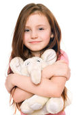 Portrait of smiling little girl with a teddy elephant — Stock Photo
