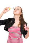 Portrait of pretty young woman blow bubbles — Stock Photo