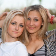 Closeup portrait of two attractive young women — Stock Photo