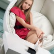 Stock Photo: Girl siting in white chair