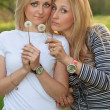 Two blonde with a dandelions — Stock Photo #7385081