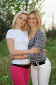 Portrait of two smiling pretty young women — Stock Photo