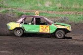 Race for survival. Green yellow car — Stock Photo