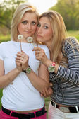 Two blonde with a dandelions — Stock Photo