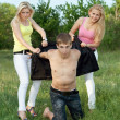 Two playful blonde and young man outdoors — Stock Photo