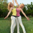 Two happy attractive blonde in white jeans — Stock Photo