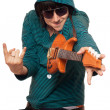 Man in sunglasses with a little guitar — Stock Photo