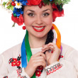 Smiling woman in the Ukrainian national clothes — Stock Photo