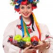Woman in the Ukrainian national clothes with fruit - Stock Photo