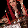 Gypsy woman sitting with cards. Isolated - Foto Stock