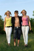 Two pretty blonde and young man walking — Stock Photo