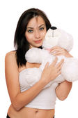 Smiling cute girl with a teddybear — Stock Photo