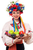 Woman in the Ukrainian national clothes with fruit — Stock Photo