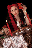 Gypsy woman sitting with cards. Isolated — Stock Photo