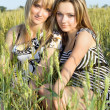 Two smiling pretty girlfriends - Stockfoto