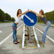 Two girls stand on a road - Stockfoto