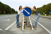 Two girls stand on a road — Stok fotoğraf