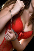 Woman in red lingerie handcuffed — Stock Photo