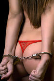 Young woman in red lingerie handcuffed — Stock Photo
