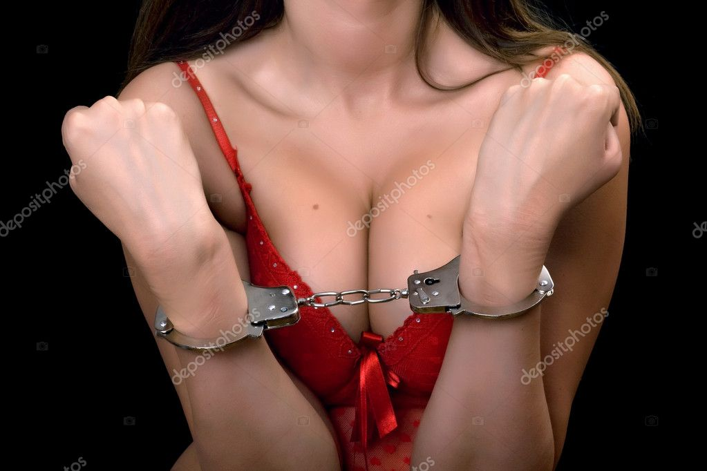 Young sexy woman in red lingerie handcuffed — Stock Photo #7852370