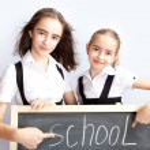 Schoolgirls about a schoolboard — Stock Photo