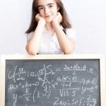 Schoolgirl on a school board — Stock Photo
