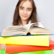 Schoolgirl reads the book — Stock Photo
