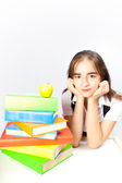 Schoolgirl and books and apple — Stock Photo