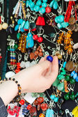 Hand of the girl with jewelry — Stock Photo
