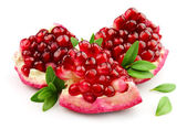 Sweet pomegranate with leafs — Stock Photo