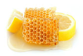 Honeycomb close up with lemon — Stock Photo