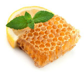 Honeycomb with mint and lemon — Stock Photo