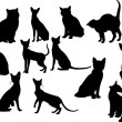 Twelve cats silhouettes. Vector illustration — Stock Vector