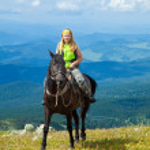 Rider on horseback at mountains — Stock Photo #6806156