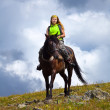 Stock Photo: Female rider on horseback