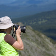 Nature photographer on mountain — Stock Photo