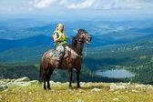Female rider on horseback — Stock Photo