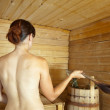 Woman taking steam in sauna — Stock Photo