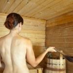 Woman taking steam in sauna — Stock Photo
