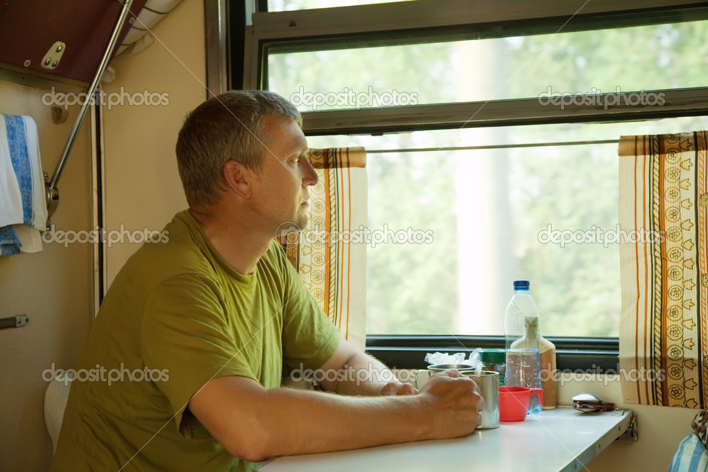 Mature man looking to window in sleeper train — Stockfoto #6813360