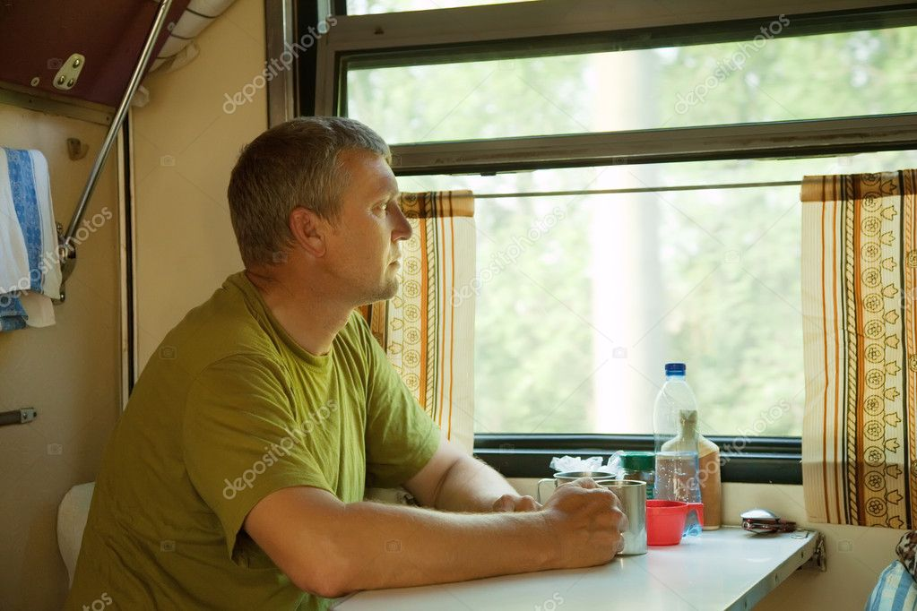 Mature man looking to window in sleeper train  Foto Stock #6813360