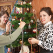 Family decorating Christmas tree at home — Stock Photo #6854223