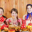 Stock Photo: Women eats pancake with tea during Shrovetide
