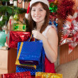 Girl with christmas gifts — Stock Photo #6854248